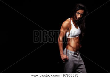 Female Athlete Posing With Jumping Rope