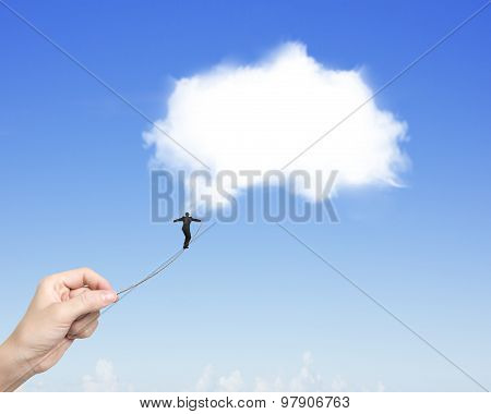 Businessman Walking Tightrope Woman Hand Pulling Toward White Cloud