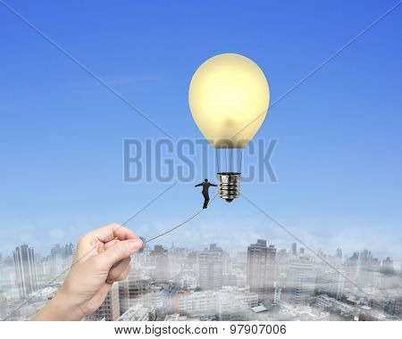 Businessman Walking Tightrope Woman Hand Pulling Lightbulb Hot Air Balloon