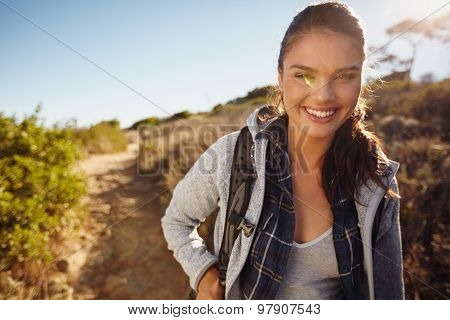 Young Female Tourist Hiking In Nature