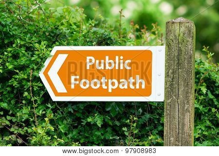 Direction Arrow, Sign To Public Footpath In Orange Color
