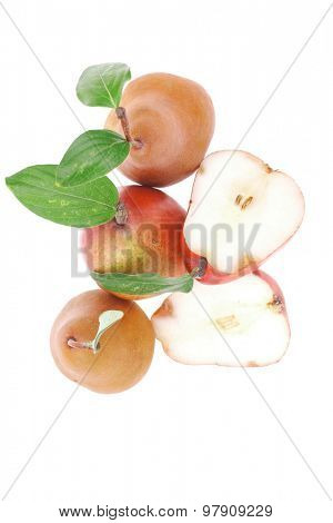 red and gold pears with halfs isolated over white background