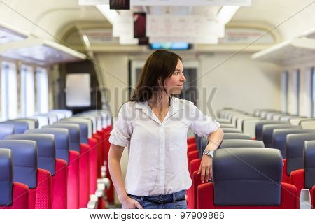 Young happy girl traveling by train