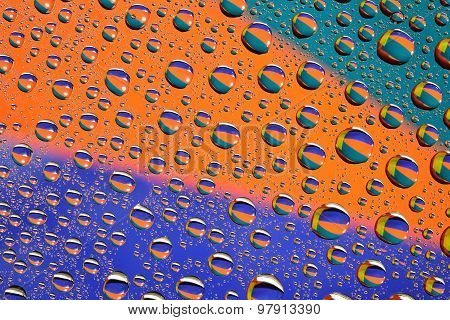 Water Drops On Multicolor Background