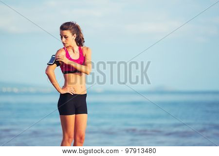 Healthy Active Lifestyle. Young sports fitness woman on the beach at sunset ready for workout.