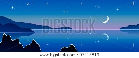 Moonrise over the sea. Laguna illuminated by the light of the moon