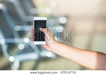 Closeup of young man use smart phone in airport inside