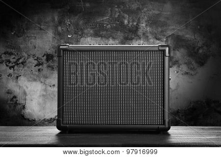 Guitar amplifier on dark background