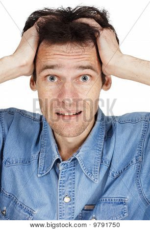 Confused Young Man Has Clasped Hands A Head