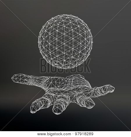 Ball on the arm. The hand holding a sphere. Polygon ball. Polygonal hand. Black background. The shad