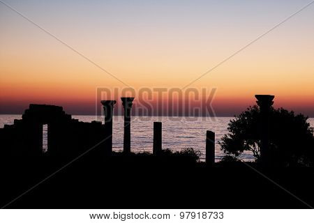 Silhouette of Chersonese ruins in Sevastopol, the Crimea under the sunset