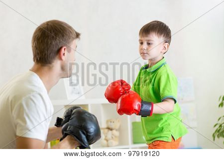 child boy and dad play boxing