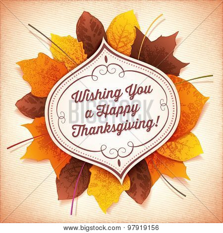 Thanksgiving Greeting Card With A White Label And Autumn Leaves