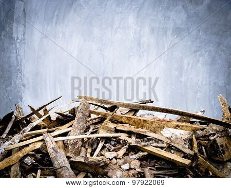 Cement wall and scraps of wood foreground,outdoor house