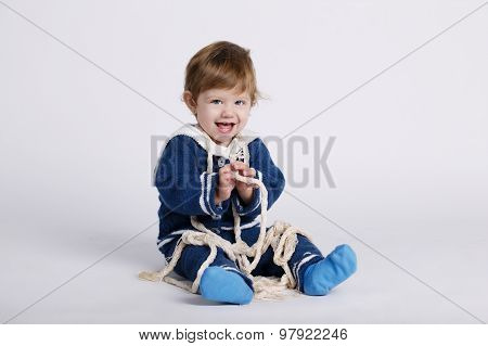 little sailor baby on white background