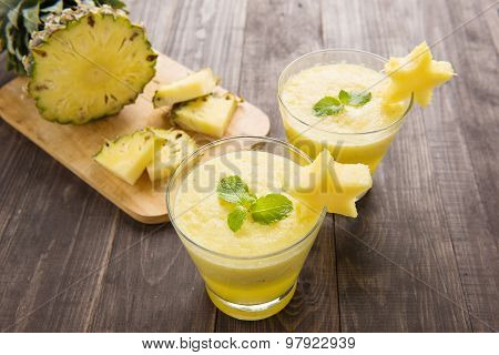 Pineapple Smoothie With Fresh Pineapple On Wooden Table