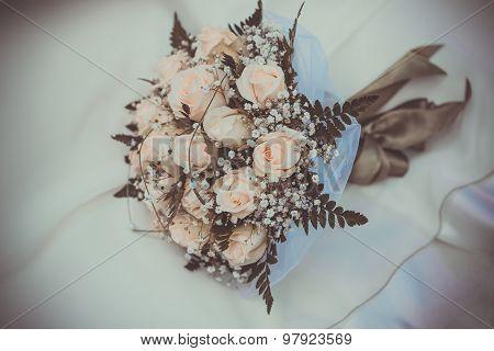 bridal bouquet on the weddind dress