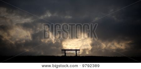Bench In The Sunset On A Dike At The Northsea