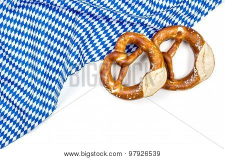 White Blue Diamond Pattern With Two Pretzels On A White Background