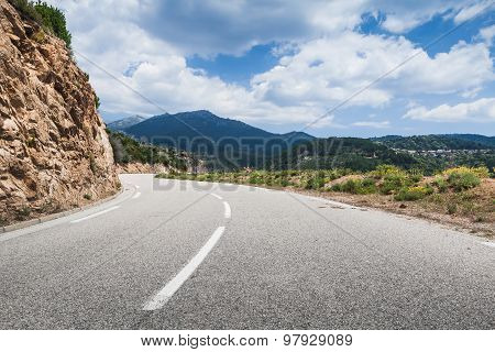 Mountain Road With Dividing Line On Asphalt