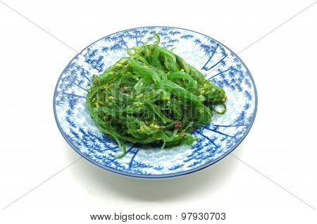 Japanese green seaweed salad on dish