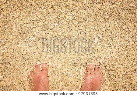 Man Feet Standing In Sand