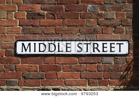 Middle Street Sign On Brick Wall.
