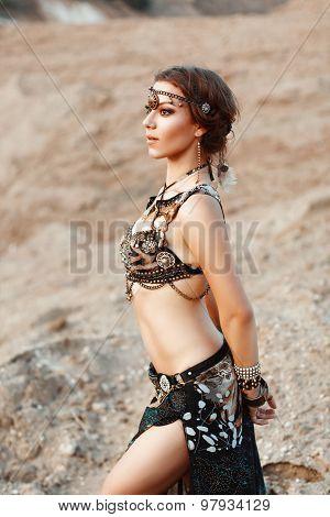 Fashion Beauty And Stylish Girls. Spirituality Dance. Beautiful Sexy Woman With Luxury Glossy Gold