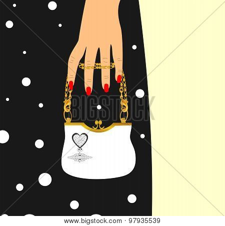 Beautiful woman's hand and a small bag