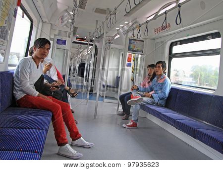 passengers are riding in the commuter train, Kuala Lumpur