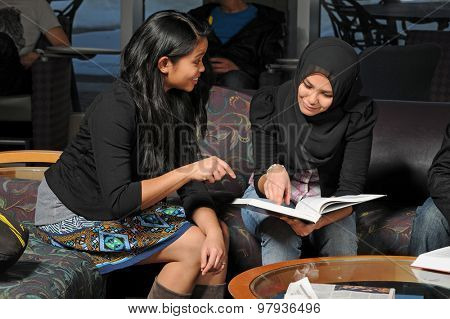 Group of ethnically diverse group of students studying