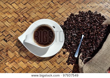 Coffee And Sac On Wooden Surface