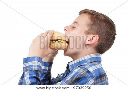 Little Boy Eating A Burger. Isolated On White Background