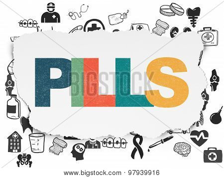 Health concept: Pills on Torn Paper background
