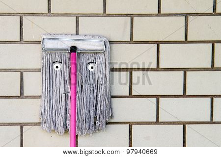 Broom Face On The Wall