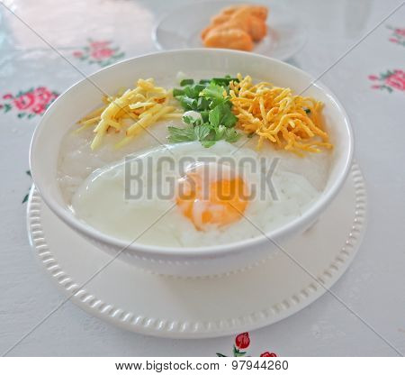 Traditional porridge rice gruel in white bowl, congee