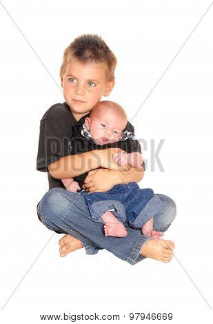 Little Boy Holding His Three Weeks Old Brother.