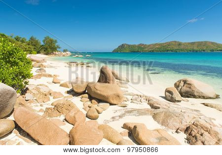 Beautiful beach Anse Boudin seen from the granite boulders, Praslin island, Seychelles.