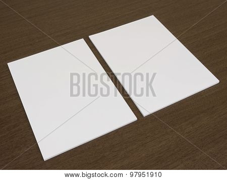Two blank white documents on a wooden background.