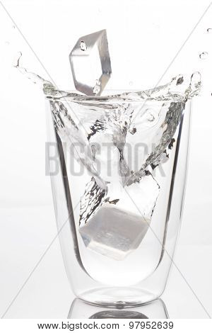 Ice Drop To Glass Of Drinking Water