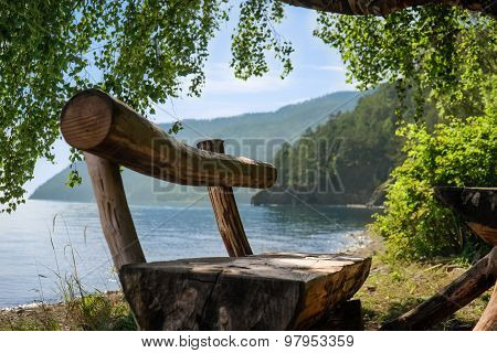 Hand Made Wooden Bench On Baikal Lake Coast