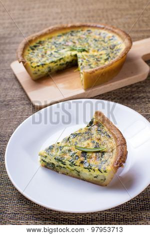 Delicious spinach quiche and smaller portion served
