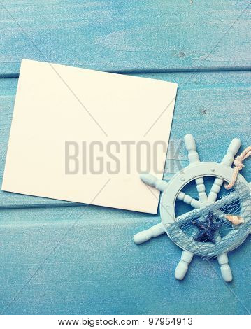 Decorative Helm And Empty Tag On Blue Wooden Background.