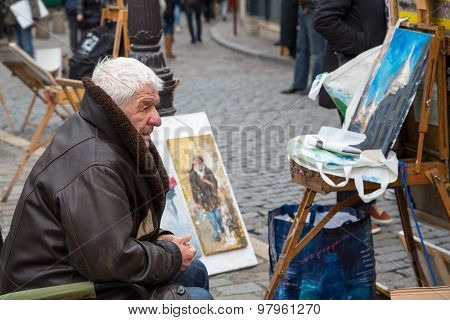 PARIS, FRANCE - MARCH 3RD: Street artists display his work in a cobbled market square in Montmartre, 18th Arrondissement. On March 3rd 2015.