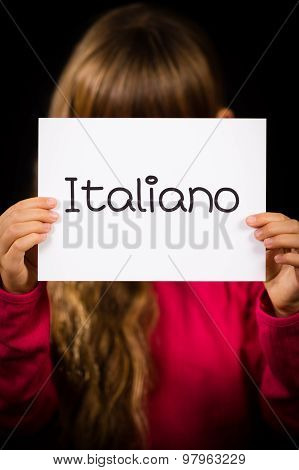 Child Holding Sign With Italian Word Italiano - Italian In English
