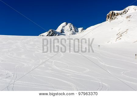 Fresh Ski Tracks On Ski Slope