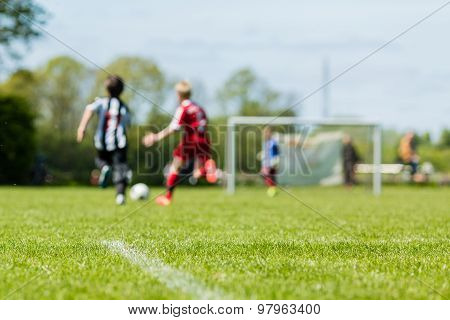 Blurred Kids Playing Soccer Match
