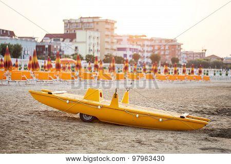 Yellow Lifeguard Boat On Beach