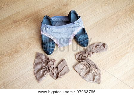 Women's Shoes, Panties And Stockings Lying On The Floor