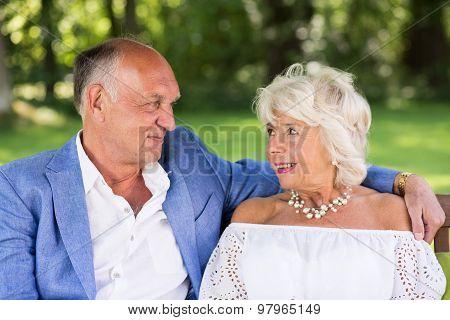 Amorous Senior Couple In Park